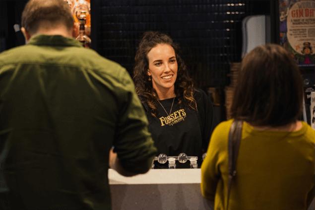 smiling woman at a bar